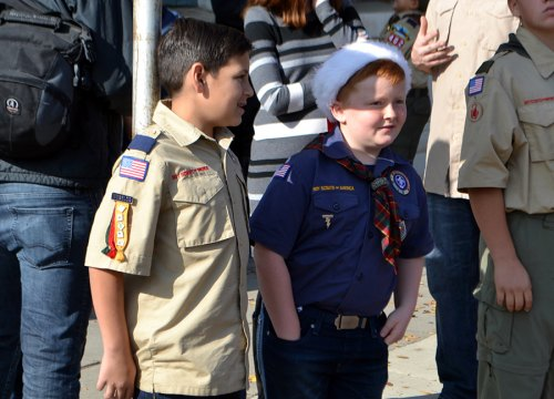 Local scouts watch the tree go up downtown.