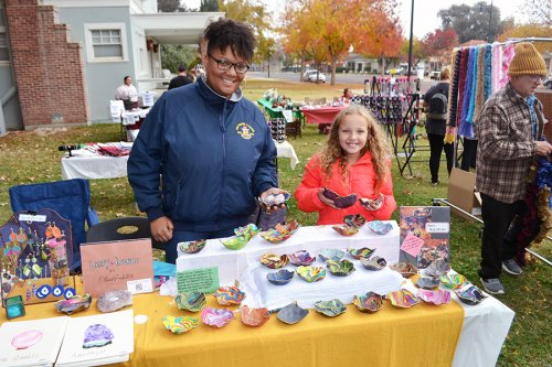 Olivia White Rochelle and daughter Mariah Brown show off their crafts as the Lemoore Sarah Mooney Museum Open House.