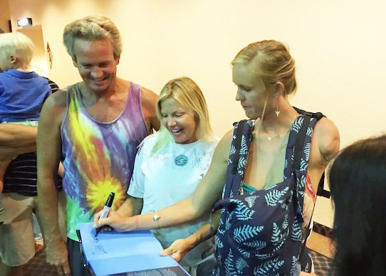 "Bethany Hamilton signs copies of her book at the premiere of her documentary ""Unstoppable"" at Lemoore's Stadium Cinemas."
