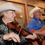 Wendall Miller and his bandmates play country music as dinners muched on lobster and steaks.