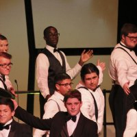 "Men's Choir singing ""Puttin' on the Ritz."""