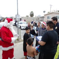 """Santa joins the Lemoore Police Department as they deliver gifts as part of the department's annual """"Presents on Patrol."""""""