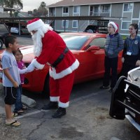 """Santa and the Lemoore Police deliver another present as part of """"Presents on Patrol."""""""