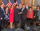 U.S. Representative TJ Cox is sworn in Thursday, Jan. 3, by House Speaker Nancy Pelosi as friends and family members join him in the Capitol.