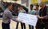 Powerade representative Seth Holm presents a $2,000 check to LHS's Scott Bueller. Joining Bueller L to R are Todd Johnson, Ethan Powers, Nicholas Leon, and Branden Kaiser. The four helped to make the video.