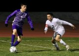 Lemoore's Armando Salinas and Nipomo's Carlos Diaz battle for the ball in Wednesday's Div. 2 playoff game which the Tigers won 4-0. Lemoore will host McLane High Friday night in Tiger Stadium.