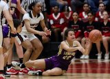 Lemoore's Nyomi Solis passes the ball in Thursday night's West Yosemite League final at Hanford. The Tigers lost but will enter the Central Section playoffs.