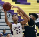 Lemoore freshman Jaelyn Proby looks to score in fourth quarter against Fresno High in the first round of playoffs Wednesday night in Lemoore's Event Center.