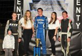 Keith Day Jr. stands proudly atop the podium after his first win at the Keller Auto Speedway Saturday night.