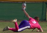 Lemoore's Sierra Phelps makes a spectacular catch in a recent game for the Tigers.