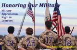 Members of the Lemoore High School baseball team stand at attention before the start of Friday night's game. The team was celebrating Military Appreciation Night.