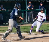 Lemoore's Ozzie Hernandez scored the Tigers only run Friday as his team lost a 12-1 decision to visiting Redwood.