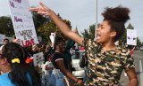 Anaya Keller Jones leads a chant during Monday's protest march through Lemoore.