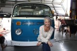 Michelle Moreau Keener, a 1983 Lemoore High School grad, with her 1976 Volkswagen bus named Gwennie the Wandering Bird.