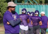 First-year Lemoore High School football coach Josh Kloster reviews his team during Tuesday practice session. The Tigers open their season Friday at Clovis East.