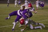 Lemoore's Will Schalde catches a pass from Justin Holaday for a first down against visiting Sanger Friday night.