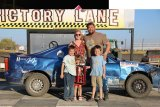 Winner Dan Myrick and his family celebrate after his mini-stock win Sunday at the Lemoore Raceway.
