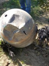 A local Hanford orchard owner found this piece of space junk - a hydrazine fuel tank - among his walnuts recently. The object is from a satellite launched by Iridium, a mobile satellite communications company.