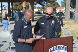 End of Watch Ride to Remember spokesperson Jagrat Shah confers with Lemoore Police Chief Michael Kendall during Saturday's tribute to Officer Jonathan Diaz in Veterans Park during which a Harley-Davidson motorcycle was donated.