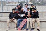 Tim Welsh (center with skateboard) celebrates winners of a skateboard competition held to benefit foster kids. Winners include Jonathan Contreras, Mark Urbieta, Ethan Ebrahim, fellow owner Tim Taylor and judges Tylorr Rodriguez and John Silva.