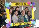 Josie Madrigal (in green) celebrates her 90th birthday in the company of her sisters, family members and friends on Dec. 21 at the Tachi Palace Hotel and Casino.