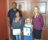 Lemoore students Grace  Berkenkamp, Akers School, and Mializeth Inocencio, from Central Union, were honored by FAST Credit Union and Assemblyman Rudy Salas' representative Damian Douglas.