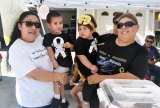 Mom Veronica Araiza and son Michael shared lemonade duties with young Jocelyn Flores and her mother Melissa Flores Saturday as they sold lemonade to help in the fight against cancer.