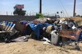 There are many homeless encampments in Hanford and Kings County similar to this one. Hanford Police Officer Mark Carrillo showed this photo, and others, to a consortium of agencies and individuals interested in creating a homeless service center.