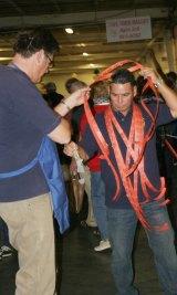 John Campana overwhelmed by 50/50 raffle tickets.