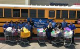 """Assemblyman Rudy Salas joined Lemoore Lions Club members and others for """"Stuff the Bus"""" Saturday at the Kmart parking lot."""