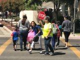 Lemoore Elementary Crossing Guard Alice Carlson says stands guard as local students end their first day off school.