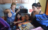 Operation Homefront Volunteer Cheryl Bass with parent Elena Maldonado and kids Esmeralda, Katherine and cousin Gisell.
