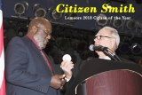 Dr. Ernie Smith accepts the Citizen of the Year Award from last year's recipient Bill Black.