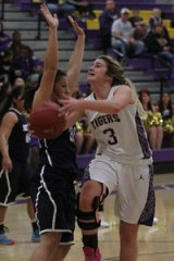 Kayla Beck goes for two points against Redwood High School.