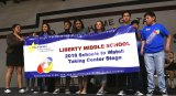 Proud Liberty Middle School students unfurl 2018 Schools to Watch Banner during Friday's (March 16) recognition event.