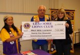 Lemoore Lions President Ever Casas and Treasurer Bill Mayer present a check for $25,000 to West Hills Lemoore President Kristin Clark. The check is a culmination of 4 years of donations to the college.