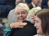 Lynn Sedgwick embraces friends following an inspirational memorial service held Saturday in the West Hills College Golden Eagle Arena to honor her late husband, Gary Sedgwick.