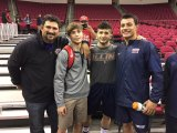Lemoore Coach Marcio Botelho, a former Bulldog wrestler, with (left to right) Gary Joint, Isaiah Martinez, and Angel Solis following Friday's Fresno State wrestling match at the Save Mart Arena.