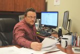 "Lemoore 'Interim"" City Manager Nathan Olson in his Cinnamon Complex office recently preparing for another meeting."