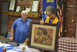"""Lions Club President Ray Etchegoin accepts gift from outgoing """"Guiding Lions"""" Bill and Carrie Diltz."""