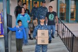NAS Lemoore Seabees help with gifts.