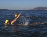 Lemoore's Stephanie Bealer takes a swim from Alcatraz on October 14 to promote Native American issues.