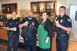 """Lemoore Cmdr. Steve Rossi (left) with Officer Mark Pescatore, Starbuck's Manager Mellissa Harbotte and Office Anthony Braley at """"Coffee with a Cop."""""""