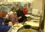volunteers prepare meals at Community Thanksgiving dinner on Thursday.