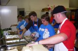 Volunteers at the 2011 Community Dinner prepare over 1,900 meals.