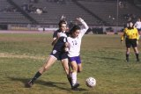 Lemoore's Yavilex Ledezman keeps her eye on the ball during overtime loss to Redwood.