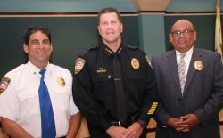 Lemoore Chief Darrell Smith welcomes new chaplains Dave Droker (left) and Robert Flores (right) to the police department.