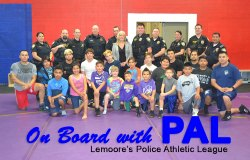 Police officers, friends and kids get together for Police Athletic League event at the Cinnamon Recreation Complex.