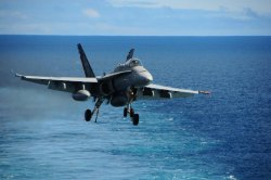 An FA-18 Hornet coming in for a landing.