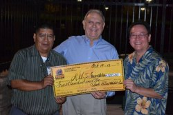 Bill Black (center) receives a check from the Tachi Palace's Willie Barrios former Tiger George Will looks on.